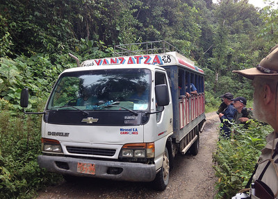 An open-air bus from isolated villages.