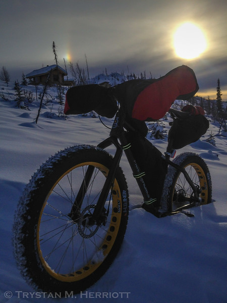 A fine day on the trail with the Hogback, with sun and sundogs and at times 35° F below zero with wind-chill. A backcountry cabin awaited my fellow travelers and me at the end of the day, and was a welcome site after a 30-mile ride in the White Mountains National Recreation Area north of Fairbanks, Alaska.