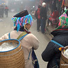 Two Hmong women with baskets in Sapa, Vietnam in January 2012