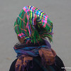 Woman with a brightly coloured headscarf in Sapa, Vietnam in January 2012
