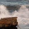 A wave breaking on rocks at Yamba, February 2012