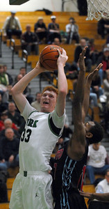 York's Frank Toohey goes up for a basket during their game against Kenwood at the 39th annual Jack Tosh Holiday Classic held at York High School Wednesday Dec. 26, 2012. Erica Benson—ebenson@shawmedia.com