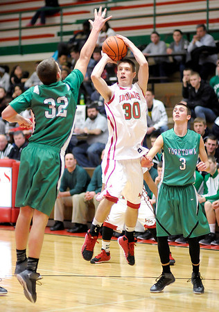 Don Knight / The Herald Bulletin<br /> Anderson's Aaron Karr shoots as he is guarded by Yorktown's Riley Neal (32) and Caleb Morey (3).