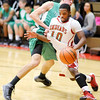 Don Knight / The Herald Bulletin<br /> Anderson's Kenya Wilkerson draws a foul from Yorktown's Riley Miller as he drives the baseline on Friday.