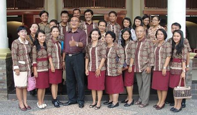 Teachers and staff in traditional Indonesian prints. Fr. Kusmaryadi is in the front row, third from the right.