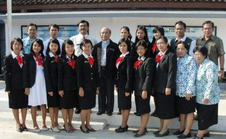 Fr. Kusmaryadi (center) with teachers and staff of Yos Sudarso Senior High School