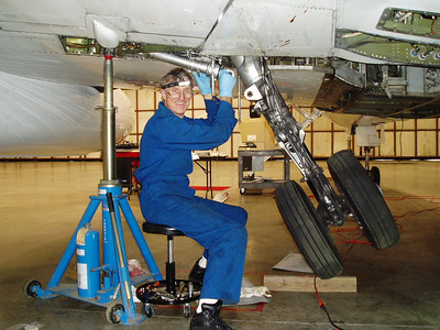 Getting my hands dirty carrying out maintenance to keep the bird flying!