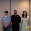 St. Thomas Aquinas Church.  Patrick Kurecka, Fr. Nick Coffaro and Marissa McConnell.