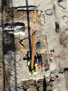 First structural column being set.