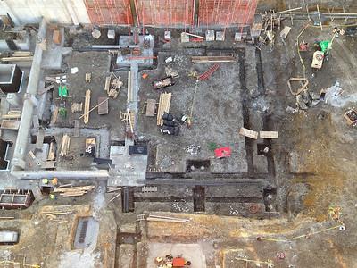 Escalators sculpting the site.