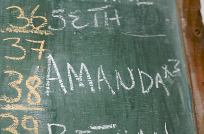 "At ChaChaCha's Backpackers in Lusaka, we were greeted with ""Amanda x 3"" on the reservations chalkboard :)"