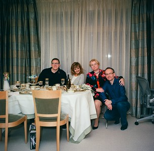 Christmas Day 2016 with Megan and Dave. Negative: Kodak Ektar, 100 ASA. Taken using self-timer and a Sunpak flash bounced from the ceiling.