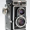"This is the camera I used to take pictures shown in this gallery  (Zeiss Ikon Ikoflex Ic). Zeiss made them between 1956 and 1960. The ""Novar-Anastigmat"" taking lens is only a triplet (Zeiss also made a version with a better 4-element Tessar lens), but due to the sheer size of the negative (60 x 60 mm square on a 120 roll film), it is able to capture  quite a bit of detail. The upper lens is for the viewfinder only. I think these cameras were supposed to be poor man's Rolleiflexes, but somehow never really caught on."