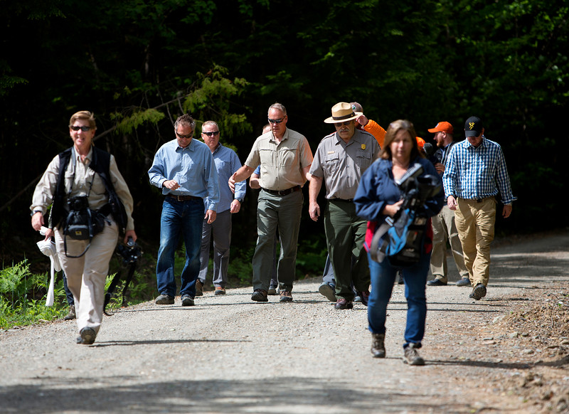 KATAHDIN WOODS AND WATERS NATIONAL MONUMENT, Maine -- 06/14/2017 - U.S. Secretary of the Interior Ryan Zinke (center) walks with Matthew Polstein (left), Katahdin region business man, during a tour of the Katahdin Woods and Waters National Monument Tuesday. The visit was the start of a four-day visit to New England. Katahdin Woods and Waters National Monument is currently under  review via President Trump's Executive Order 13792, issued April 26, 2017. Ashley L. Conti | BDN