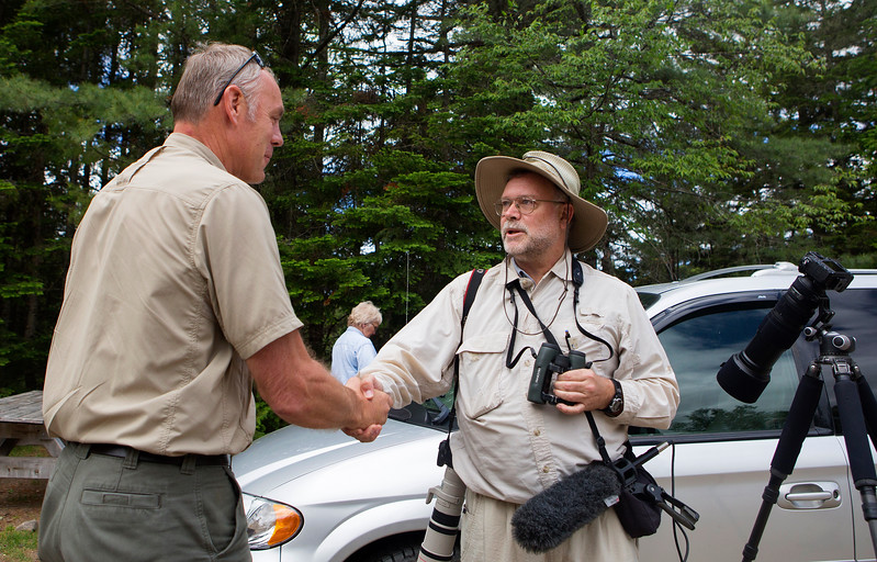 KATAHDIN WOODS AND WATERS NATIONAL MONUMENT, Maine -- 06/14/2017 - U.S. Secretary of the Interior Ryan Zinke (left) shakes the hand of Lance Benner, a bird watcher, during a tour of the Katahdin Woods and Waters National Monument Tuesday. The visit was the start of a four-day visit to New England. Katahdin Woods and Waters National Monument is currently under  review via President Trump's Executive Order 13792, issued April 26, 2017. Ashley L. Conti | BDN