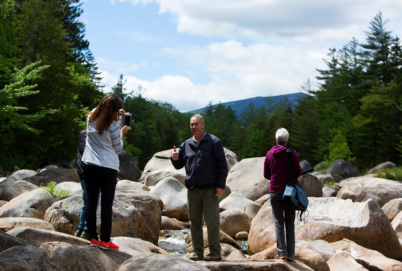 KATAHDIN WOODS AND WATERS NATIONAL MONUMENT, Maine -- 06/14/2017 - U.S. Secretary of the Interior Ryan Zinke (center) poses for a photo for Heather Swift during a tour of the Katahdin Woods and Waters National Monument Tuesday. The visit was the start of a four-day visit to New England. Katahdin Woods and Waters National Monument is currently under  review via President Trump's Executive Order 13792, issued April 26, 2017. Ashley L. Conti | BDN