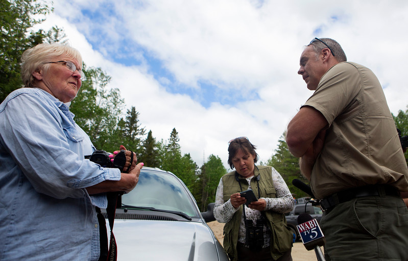 KATAHDIN WOODS AND WATERS NATIONAL MONUMENT, Maine -- 06/14/2017 - U.S. Secretary of the Interior Ryan Zinke (right) takes a minute to chat with Sharon Fiedler (left) and Anita Mueller during a tour of the Katahdin Woods and Waters National Monument Tuesday. The visit was the start of a four-day visit to New England. Katahdin Woods and Waters National Monument is currently under  review via President Trump's Executive Order 13792, issued April 26, 2017. Ashley L. Conti | BDN