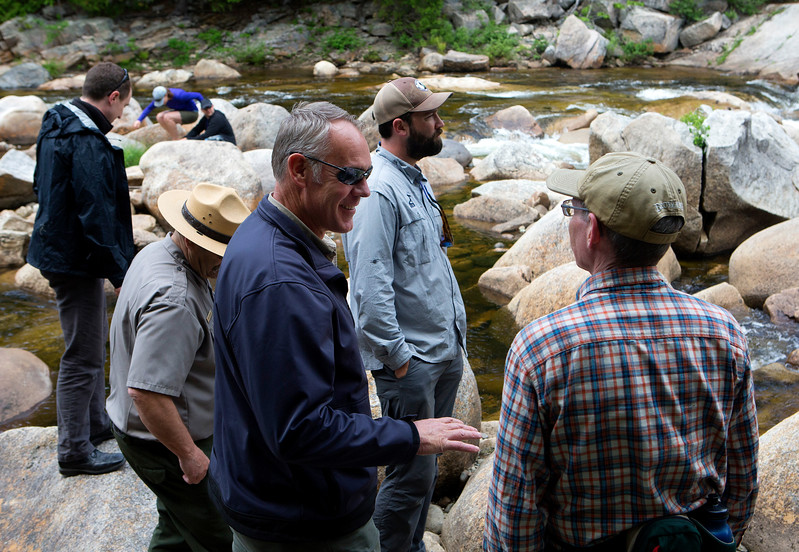 KATAHDIN WOODS AND WATERS NATIONAL MONUMENT, Maine -- 06/14/2017 - U.S. Secretary of the Interior Ryan Zinke (left) chats with outdoor enthusiasts during a tour of the Katahdin Woods and Waters National Monument Tuesday. The visit was the start of a four-day visit to New England. Katahdin Woods and Waters National Monument is currently under  review via President Trump's Executive Order 13792, issued April 26, 2017. Ashley L. Conti | BDN