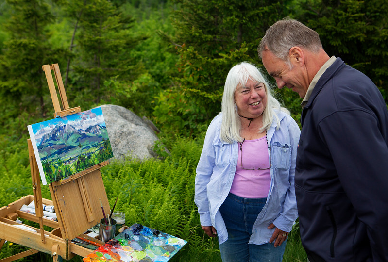 KATAHDIN WOODS AND WATERS NATIONAL MONUMENT, Maine -- 06/14/2017 - U.S. Secretary of the Interior Ryan Zinke (right) chats with Masha Donahue about her painting of Mount Katahdin during a tour of the Katahdin Woods and Waters National Monument Tuesday. The visit was the start of a four-day visit to New England. Katahdin Woods and Waters National Monument is currently under  review via President Trump's Executive Order 13792, issued April 26, 2017. Ashley L. Conti | BDN