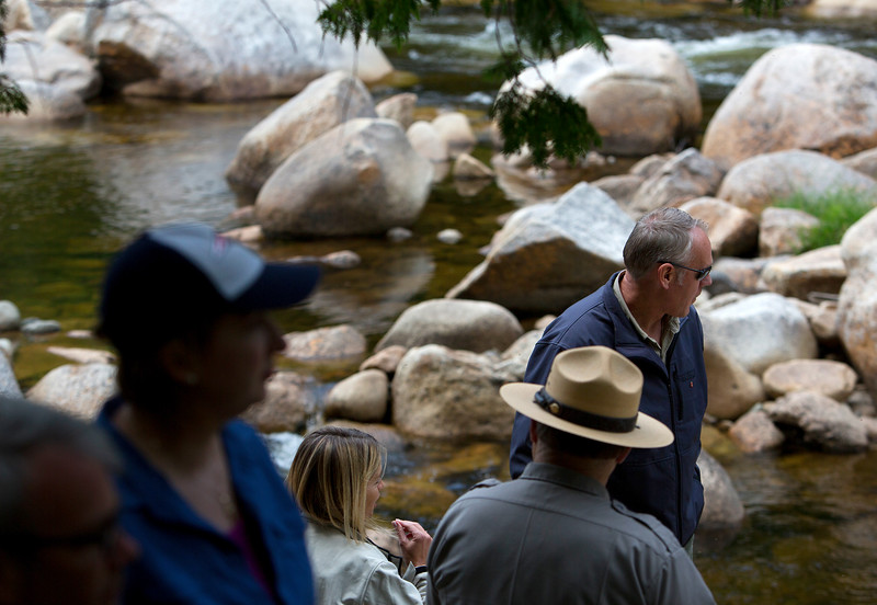 KATAHDIN WOODS AND WATERS NATIONAL MONUMENT, Maine -- 06/14/2017 - U.S. Secretary of the Interior Ryan Zinke (right) looks over the water during a tour of the Katahdin Woods and Waters National Monument Tuesday. The visit was the start of a four-day visit to New England. Katahdin Woods and Waters National Monument is currently under  review via President Trump's Executive Order 13792, issued April 26, 2017. Ashley L. Conti | BDN