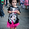 Little girl zombie with bone