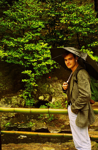 It may be the only time I ever carry, let alone use, an umbrella: me in Japan.