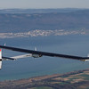 German test pilot Markus Scherdel, steers the solar-powered Solar Impulse HB-SIA prototype airplane during his first flight over the Lake of Neuchatel April 7, 2010. The propeller plane, with a 61 metres (200 feet) wingspan, is powered by four electric motors and designed to fly day and night by saving surplus energy from its 12,000 solar cells in high-performance batteries.  Wednesday's flight follows six years' work by 50 engineers and technicians led by Swiss adventurer Bertrand Piccard on the so-called Solar Impulse project. <br />    REUTERS/Christian Hartmann  (SWITZERLAND)