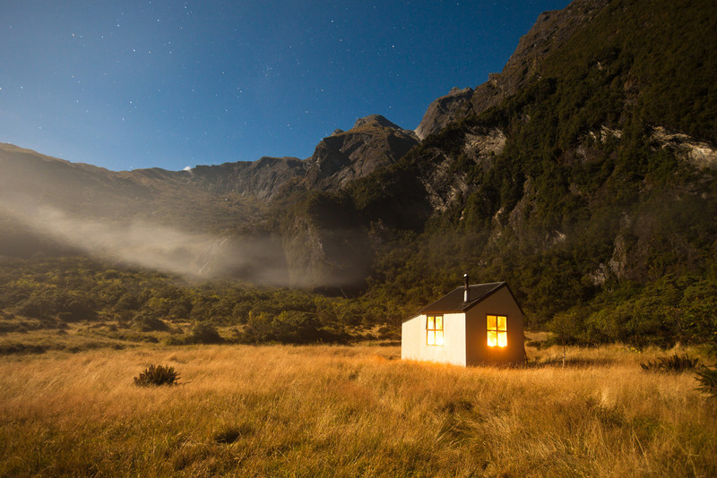 Moonlit 30 second exposure of Christmas Flat Hut. Karangarua Saddle is the low point in the background.