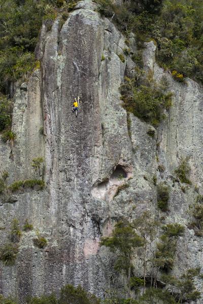 Man rock climbs at Whanganui Bay