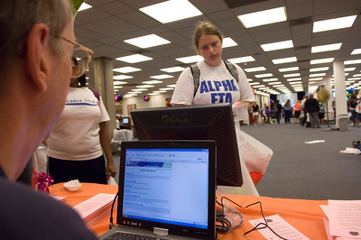 Senior Maureen LeGuern visits the Learning Express Library booth at the Library Extravaganza held at Cunningham Memorial Library on Thursday, September6.