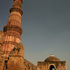 At 238 feet the Qutb Minar in Delhi, completed in 1386 AD, is still the world's tallest brick minaret. For centuries it was one of the tallest towers in the whole world. The tower's five stories were built by succeeding rulers after the Muslim conquest of India, and the unique design - which is wider at the base than at the top - gives it the appearance of even greater height.