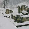 Even in heavy snow, water must be fetched from the river. In the background are the ancient ruins of a Hindu temple. Kashmir, India.