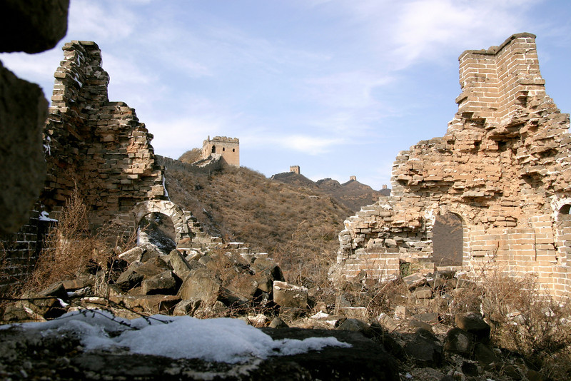 Ruins of a watchtower on the Great Wall. Notice the towers going off into the distance on the horizon.