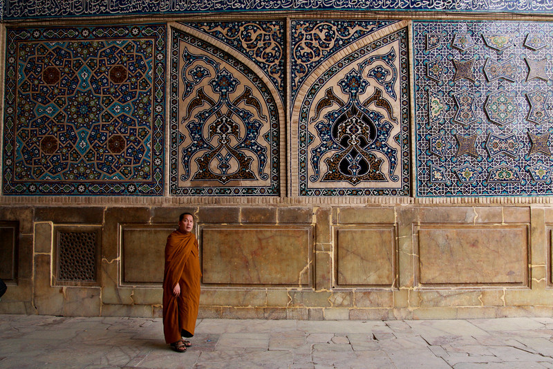 A Buddhist monk touring the main mosque in Esfahan provides a little bit of incongruity