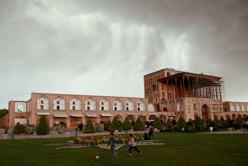 Children play soccer in front of the Ali Qapu Palace (under restoration) in Esfahan's Imam Square, as a storm approaches
