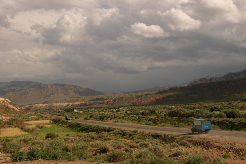 A truck lumbers along the highway from Bishkek to Lake Issykul in the Tien Shan mountains, Kyrgyzstan