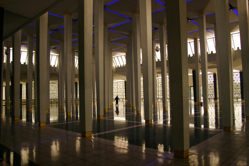 Keeping the floors clean in a hall of the Negara Mosque, Kuala Lumpur