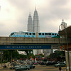 Kuala Lumpur, Malaysia: the monorail cruises by, underneath the watchful gaze of the world's 4th- and 5th-tallest buildings