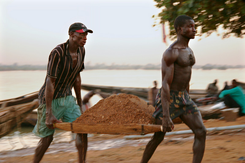 These men were unloading sand on the riverbank all day long