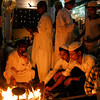 Supplicants warm themselves by a fire at a Sufi shrine in Lucknow, Uttar Pradesh