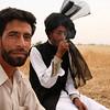 A couple of friends in Jammu, one enjoying a bidi (local cigarette)