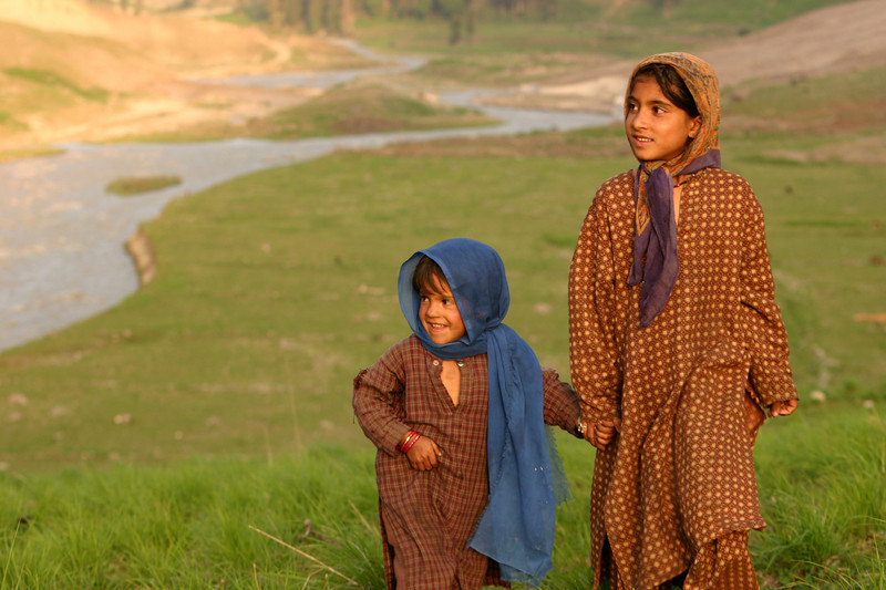 Gujjar girls out for a walk near their family's summer grazing grounds in Kashmir