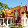 A huge portrait of the King graces the front of an ornate temple building at Doi Suthep near Chiang Mai. The King of Thailand is currently the world's longest-ruling monarch and is beloved by the entire country.