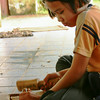 This little girl was making wooden carvings to sell to tourists