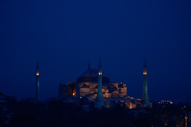 Hagia Sophia peers eerily through the dusk, in Istanbul