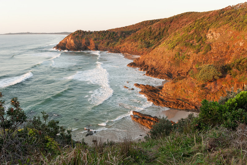 Whites Beach, and Jews Point, Broken Head Nature Reserve.<br /> Golden light of sunrise.
