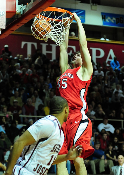 26 November 2010: Rutgers Scarlet Knights forward Gilvydas Biruta (55) dunks in the first half against the Saint Joseph's Hawks at the Philly Hoop Group Classic played at the Palestra in Philadelphia, PA.