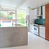 Kitchen with Waterfall Concrete Counters, Made by Hand