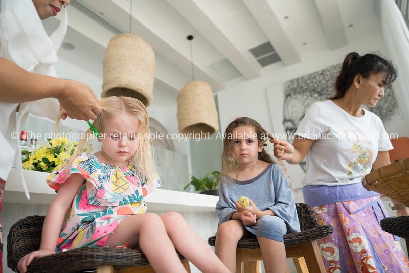 Frida and Macy getting hair braids,