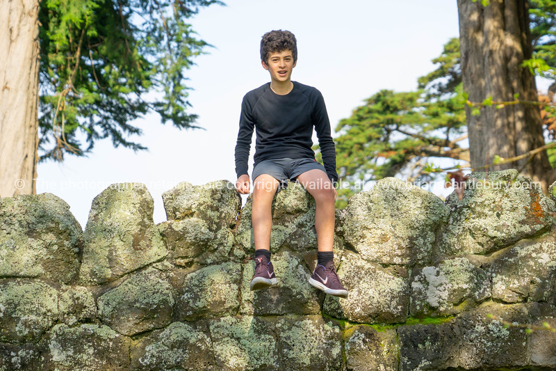 Lennox on top of stone dunnies.